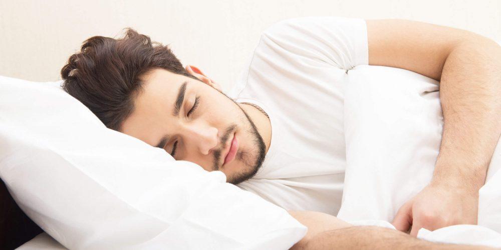 Young man sleeping soundly using Snoring Devices Hamilton