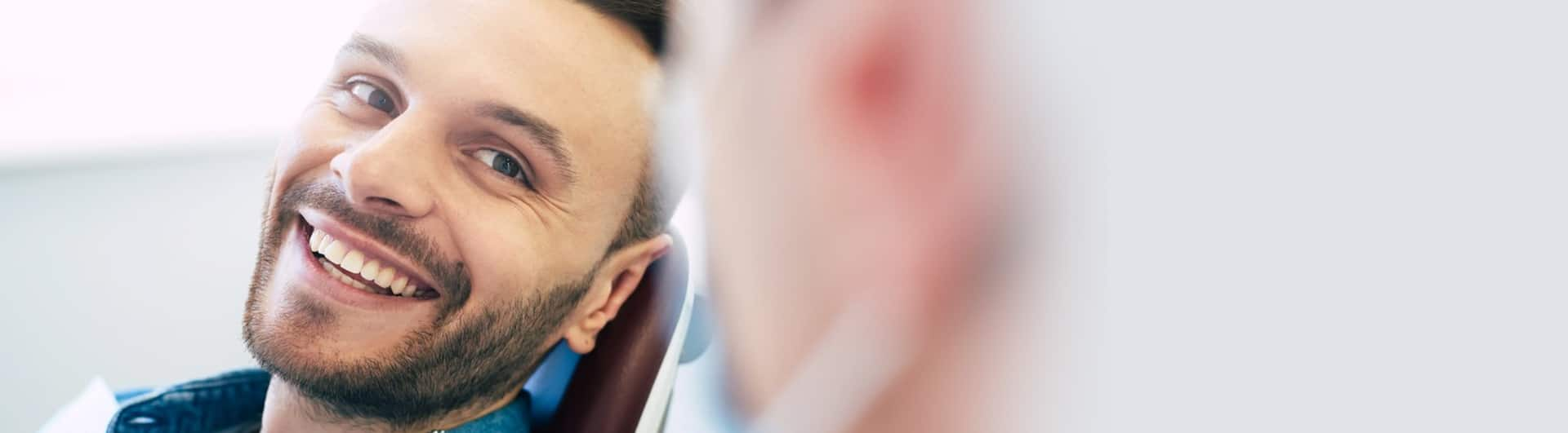 Young bearded man smiling after Restorative Dentistry Hamilton